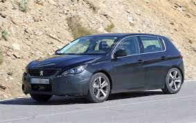 peugeot hatchback 308 peugeot 308 facelift spied with little camouflage expect it in