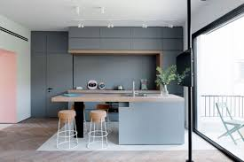 small apartment kitchen design colorful bedding wooden countertop