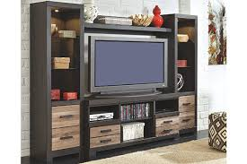 living room entertainment furniture harlinton 4 piece entertainment center ashley furniture homestore