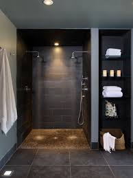 dark gray ceramic wall tile towelshelf shower head recessed
