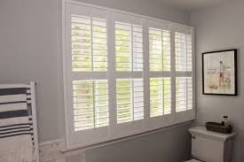 decorating grey paint wall with white plantation blinds also free