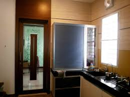large kitchen with window blinds designed by ar mohanraj annakodi