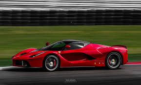 ferrari custom paint ferrari laferrari on race track rosso corsa paint side view