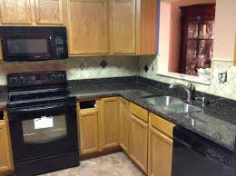 l shape kitchen design with black granite kitchen countertop