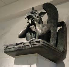 Denver International Airport Murals Removed by Gargoyle Sits In Suitcase Sticking His Tongue Out At The Denver