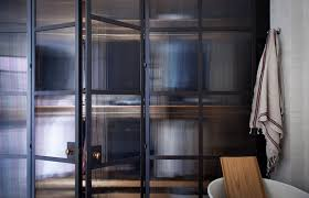 plain english bespoke british kitchen design comes to the us an industrial chic bathroom with steel framed glass doors by plain english remodelista