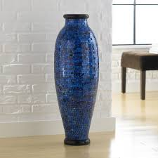 blue floor vase with unique vas and bench and laminate flooring