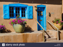 colorful adobe house with flowers on canyon road santa fe new