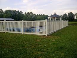 vinyl cayuga yard fence installed around an inground pool in
