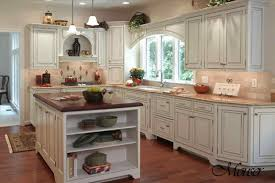 of country decorating style all white cabinets chrome handles