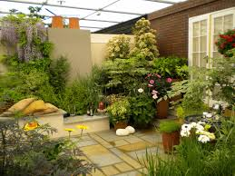 outdoor a terrace house with a garden full of plants and flowers