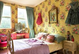 colorful picture on cute wallpaper in bohemian style bedroom with
