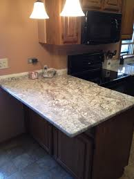 Kitchen Cabinets In Chicago Galaxy White Granite On Oak Cabinets White Spring Countertop