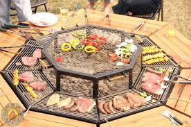Bbq Firepit The Ultimate Pit Bbq And Table Combo Grill 1001 Gardens