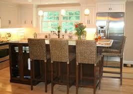 ebony wood nutmeg madison door two tier kitchen island backsplash