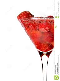 martini glass spilling strawberry in martini glass with champagne stock photos image