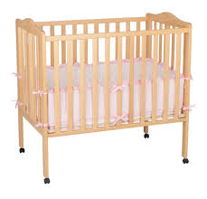 Folding Mini Crib by Delta Children Delta Fold Away 3 In 1 Portable Crib Natural