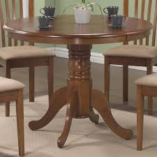 round wood table with leaf vignettes