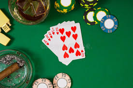 poker table top and chips set to playing poker with cards and chips on green table top view