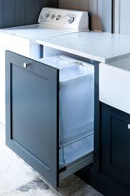 top load washer with sink under a white marble countertop fixed between a farmhouse sink and a