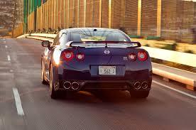 Nissan Gtr Back - feature flick watch a nissan gt r drag race a porsche 911 turbo s