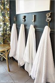 bathroom towel ideas 17 best ideas about bathroom towel hooks on half