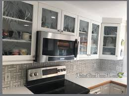 buy kitchen cabinet glass doors patti s pelicans kitchen cabinets etched glass doors florida
