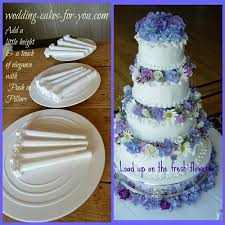 cake pillars tiered wedding cakes