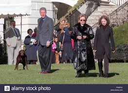 u s president bill clinton walks from the white house with first