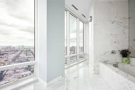 marble bathtub white marble bathtub under large mirror in bathroom with excerpt