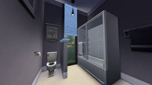 introducing mystic s sims 4 house builds house tours the sims the bathroom shares a similar gray tone to the kitchen i decided to add a half wall between the toilet and bath shower to add a bit of privacy