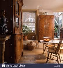 large antique cupboards and simple table and chairs in townhouse