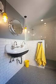 black penny tile floor with subway tile walls boys bathroom