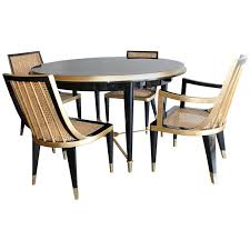gold leaf and black lacquer dining set by arturo pani mexico city