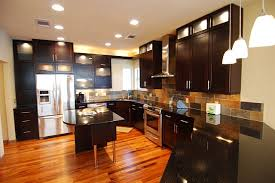 tigerwood floor with black cabinets i think it would look awesome