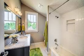 bathroom fresh bathroom with small bathtub near green cotton bathroom fresh bathroom with small bathtub near green cotton hanging towel also green rug near black banity cabinet with sink also huge wall mirror and