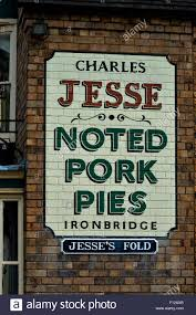 a painted business sign on the side of a shop at blists