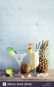 classic summer cocktails margarita and pina colada cocktails on wooden table copy space