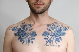 picture of blue flowers tattoos on the chest