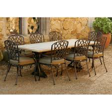 positano travertine stone 9 piece setting with whitehorse chairs