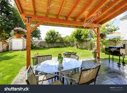 Glass Fire Pit Table Pergola Patio Area Glass Top Table Stock Photo 219872236