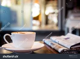 cup cappuccino newspaper on table coffee stock photo 285656429