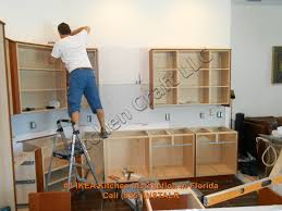 How To Mount Kitchen Wall Cabinets by Hanging Kitchen Cabinets Youtube