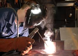 us navy 090114 n 9704l 004 hull technician fireman john hansen lays beads for welding qualifications jpg