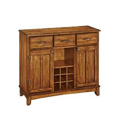 shop home styles cottage oak sideboard with wine storage at lowes com