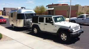silver jeep liberty 2012 new 2015 16 u0027 sport towed by jeep wrangler unlimited airstream