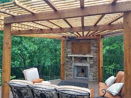 azek deck with a pergola covered outdoor fireplace in winterset woods