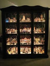 mini lights for christmas village christmas village displayed in a curio cabinet with led mini lights