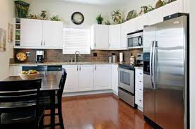 how to decorate space above kitchen cabinets how to decorate space above kitchen cabinets decorating