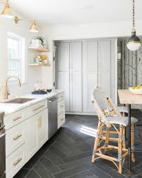 white grey brass kitchen with herringbone tile floor flooring ms